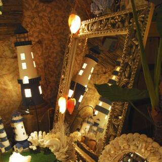Specchi di conchiglie e coralli