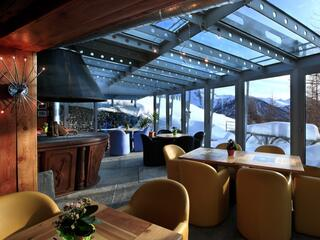Restaurant with panoramic views. At the center of the room a large fireplace warms the room and heart.