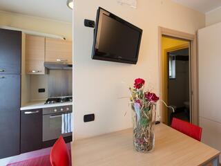 Uno degli appartamenti del Villa Regina con TV e Cucina Attrezzata