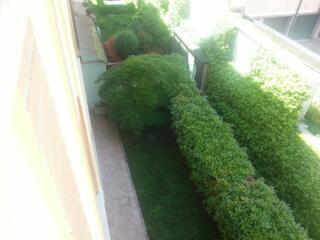 Residence Teodolinda Il giardino dell'appartamento al piano terra, fotografato dai piani più alti