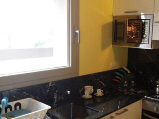 dettaglio piano cottura di una delle cucine del Residence Luna di Monza