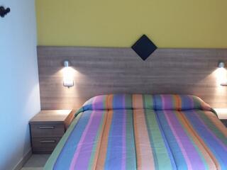 Zona letto di uno dei monolocali del Residence Luna di Monza