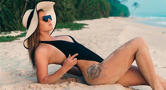 Come proteggere i tatuaggi dal sole? - Protezione Tatuaggi