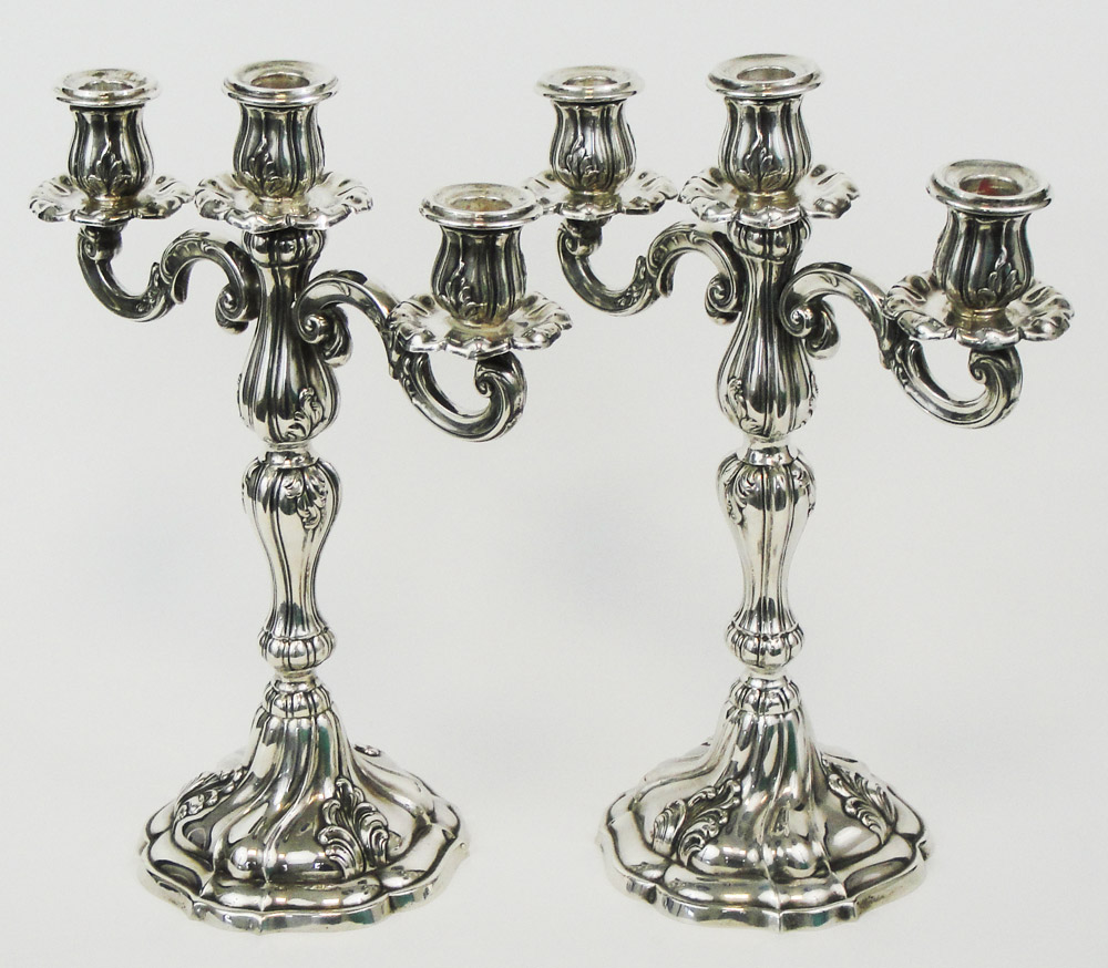 A pair of real silver candle holders first half of 20th century